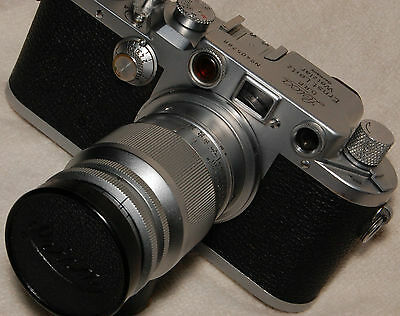 Leica IIIc camera body, 9cm Elmar f/4 portrait lens and cap,+ Orako, 4-piece set