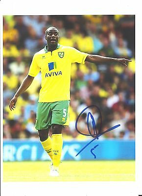 A 12 x 8 inch photo personally signed by Sebastien Bassong of  Norwich City