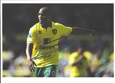 A 12 x 8 inch photo personally signed by Simeon Jackson of  Norwich City