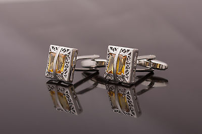 Pair of Cufflinks - silver colour openwork metal, decorated with amber