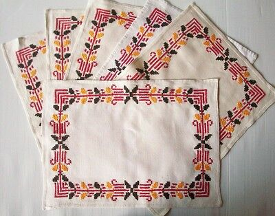 6 Hand embroidered placemats on linen red black and yellow