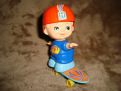 "Vintage 1979 Tomy Kid-A-Long boy on skate board White Knob Wind Up 4"" tall"