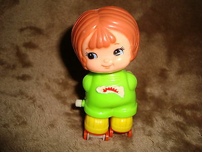 "Vintage 1979 Tomy Kid-A-Long Girl on roller skates White Knob Wind Up 3.5"" tall"