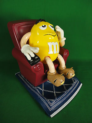 M & M Yellow Peanut M&M Character Sitting on a Recliner Candy Dispenser