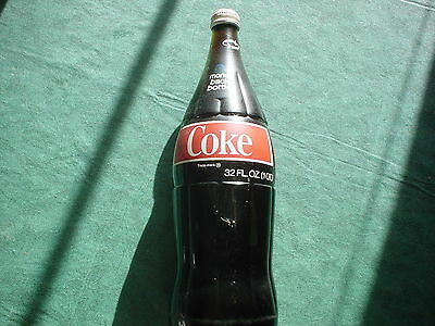 COKE COCA COLA 32 OZ BOTTLE VINTAGE NOT OPENED - TWO TOOTHBRUSHES INSIDE