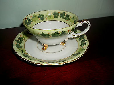 Vintage Norcrest Tri Footed Cup and Saucer Green Ivy Red Berries Gold Trim