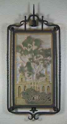 spanish mission tile in wrought iron frame