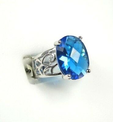 R-2510, 12x16 mm, Oval cut Sea Blue Topaz ladies Ring .925 Sterling sp Sz 8