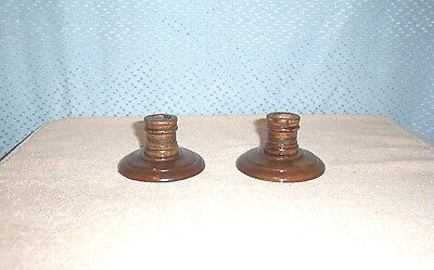 A PAIR of TURNED MAHOGANY WOOD CANDLE HOLDERS