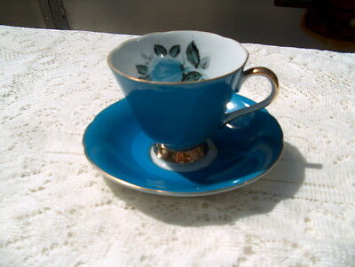 BEAUTIFUL CUP & SAUCER MARKED MADE IN JAPAN BEAUTIFUL BLUE W/GOLD & FLORAL DECOR