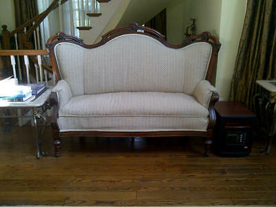 Antique victorian, walnut love seat couch, with carved faces 70 X 32 X 48 inches