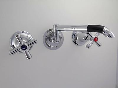Laundry taps with easy clean handles and 150mm laundry arm, chromed brass
