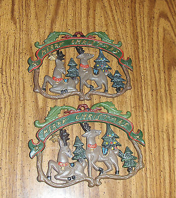 PAIR OF PAINTED CAST IRON CHRISTMAS TRIVETS REINDEER AND TREES DESIGN