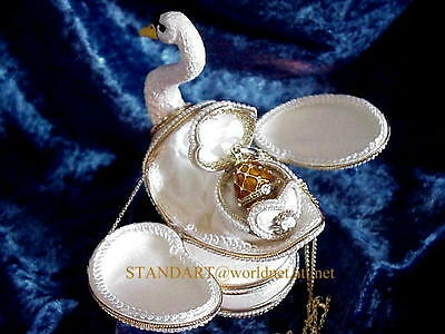"""Musical Swan Egg with inner Faberge Necklace plays """"Can't stop being in Love"""""""