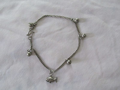 SILVER TONED ANKLET WITH BELLS & FISH
