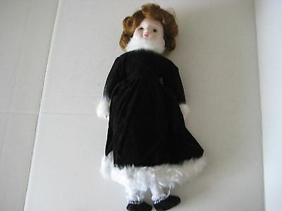 PORCELAIN DOLL- PRETTY DRESS -PRETTY FACE- WIND UP PLAYS RAINDROPS KEEP FALLING