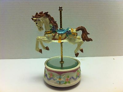 MUSICAL CAROUSEL WITH ROTATING HORSE