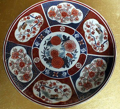Oriental plate Reds and blues and gold decorative china pottery