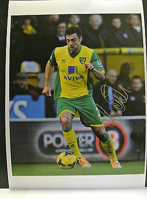 A 12 x 8 inch photo personally signed by Russell Martin of  Norwich City