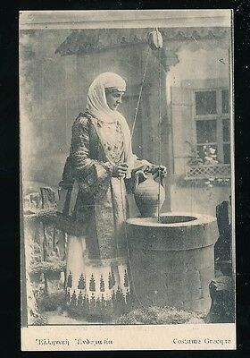 GREECE Woman in National Costume drawing water from well c1900s? PPC