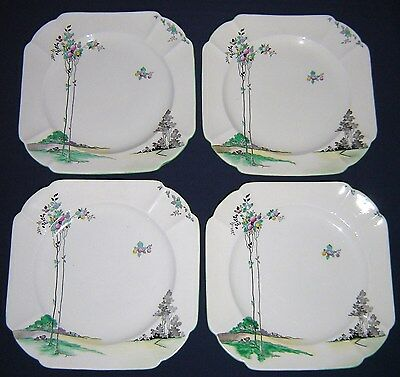 A SET OF FOUR SHELLEY QUEEN ANNE SUNRISE TALL TREES AND BALLOONS  DINNER PLATES