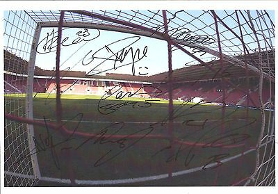 A 12x8 inch photo featurung St.Marys. Signed by 11 Southampton players 14.01.15.