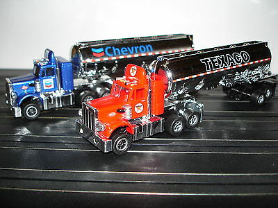 AUTO WORLD ~ 2 PETERBILT TANKER TRAILERS ~ RACING RIGS ~ ALSO FITS AFX, AW, JL