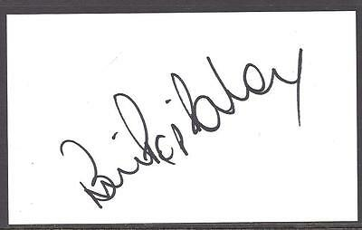 "A 13cm x 7.5cm Plain White Card Signed by Bryan ""Pop"" Robson. Newcastle United."
