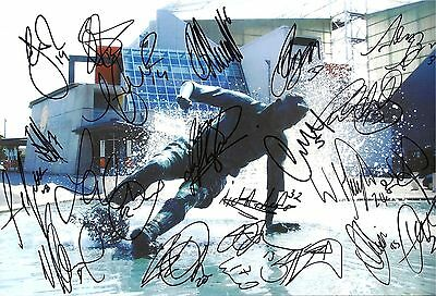 A 12 x 8 inch photo personally signed by 20 Preston North End players & staff.