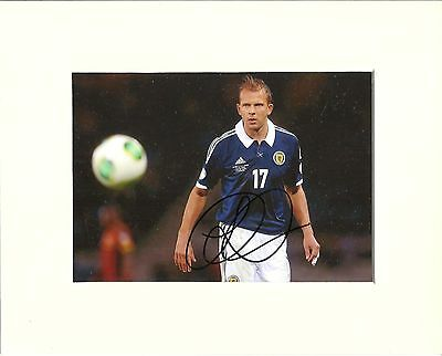 A 10 x 8 inch mount, personally signed by Jordan Rhodes of Scotland.