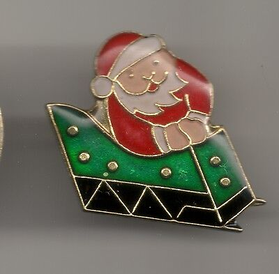 Vintage Santa Claus Riding a Present-like Sleigh old enamel pin