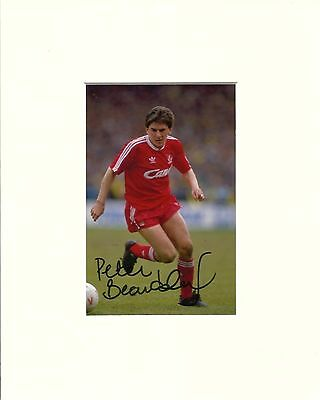 A 10 x 8 inch mount, personally signed by Liverpool player Peter Beardsley.