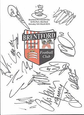 An A4 white card with the Brentford Badge. Signed by 14 players on 14.03.2015.