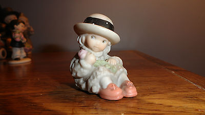 ENESCO- Kim Anderson Pretty as a Picture Girl sitting hold a rose 487651