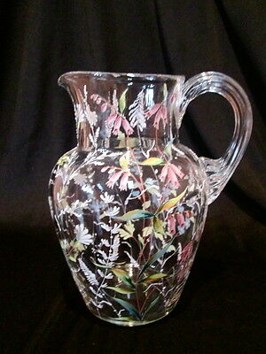 MOSER ANTIQUE CLEARE GLASS PITCHER DECORATED WITH HAND PAINTED ENAMEL FLOWERS.