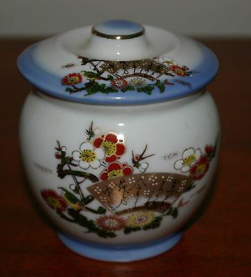 LIDDED GINGER POT BLUE TRIM WITH WRITING ON FAN
