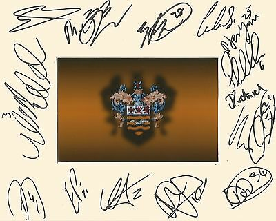 A 10 x 8 inch mount personally signed by 14 Blackpool players on 14.02.2015.