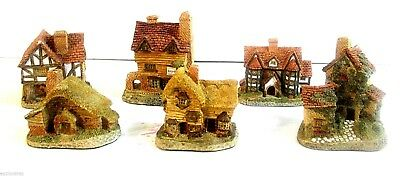 Seven Miniature Hand Made & Hand Painted David Winter Cottages From England