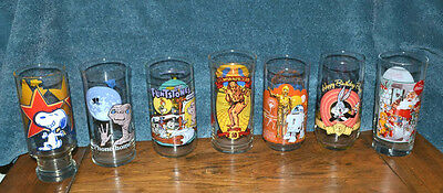 SET OF 7 DIFFERENT COLLECTOR GLASSES