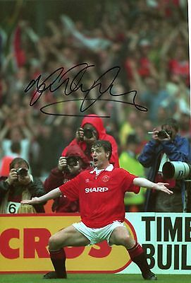 A 12 x 8 inch photo featuring & personally signed Mark Hughes Manchester United.
