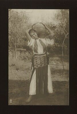 Romania National Costume Dress Girl carrying pot c1910/20s? RP PPC