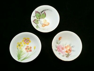 Three multi color hand painted bone china,occupied Japan sauce or tea cups