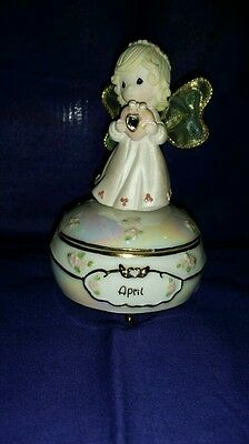 April's Blessing Precious Moments Birthstone Angel Music Box by Sam Butcher