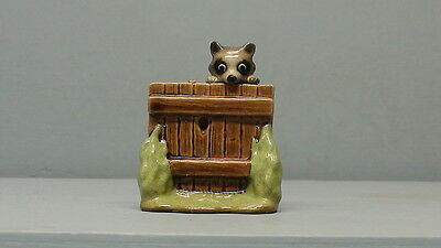 Retired Hagen Renaker Raccoon on Fence