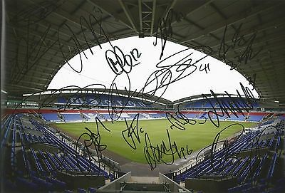 A 12 x 8 inch photo personally signed by 16 of the Bolton Wanderers squad.