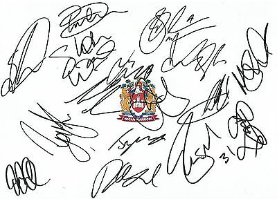 12 x 8 inch photo featuring the Wigan Warriors badge personally signed by 16.