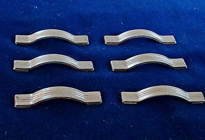 6 smooth vintage drawer pulls from a waterfall style dresser