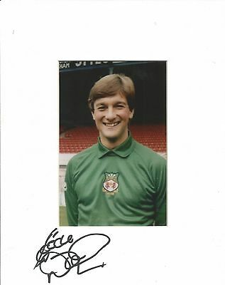 A 10 x 8 inch mount personally signed by Eddie Niedzwiecki of Wrexham.
