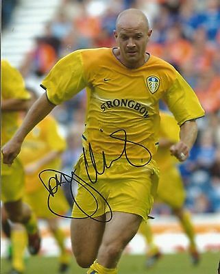 A 10 x 8 inch photo personally signed by Danny Mills when playing  Leeds United.