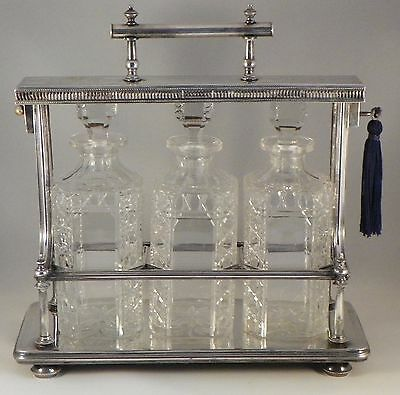 Tantalus Liquor Set.  Ornate Victorian Locking Silverplate Frame.  Circa 1890